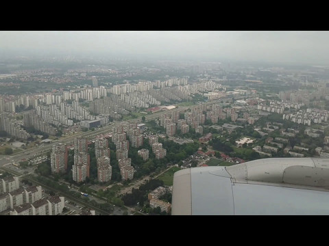Landing in Belgrade, Serbia on a cloudy day flight LH1406 from FRA
