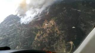 Exclusive view from above! Heavy Tanker 48 retardant drop on the Fourmile Fire, near Boulder, CO