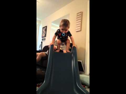 Isaac stands on slide