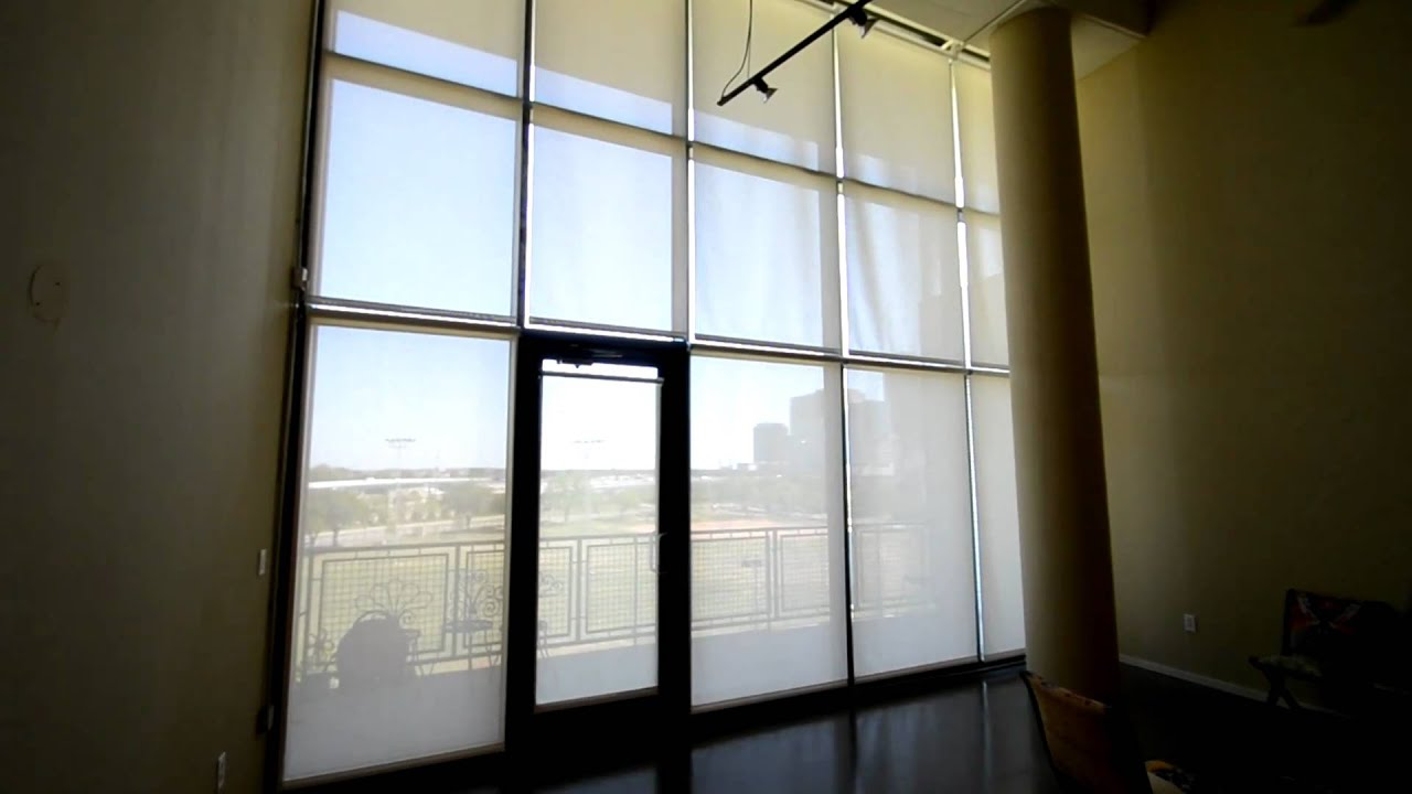 Motorized solar shades from budget blinds of park cities for Budget blinds motorized shades
