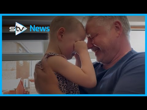 Child with cancer reunites with dad after seven weeks apart