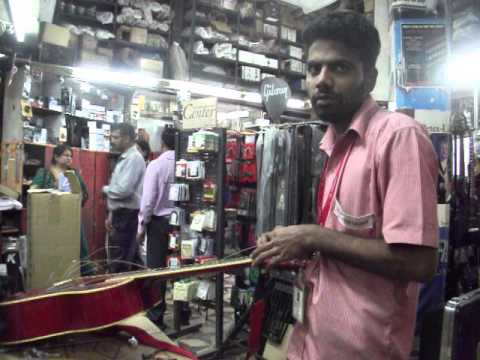 new strings for my guitar at furtado's music shop in dhobitalao mumbai india  at about 4pm  on 18thd