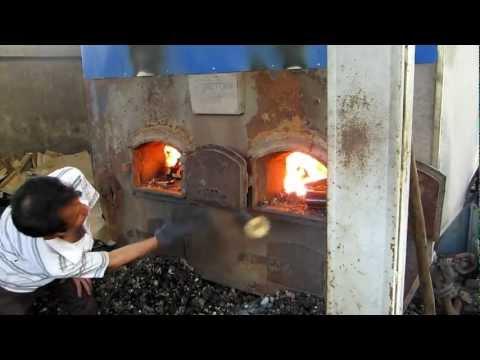 lò hơi đốt củi trấu thay thế cho than đá