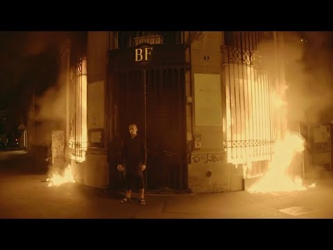 Russian artist detained after setting fire to bank in Paris