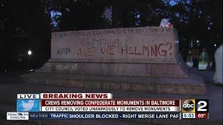 Crews remove Confederate monuments in Baltimore overnight