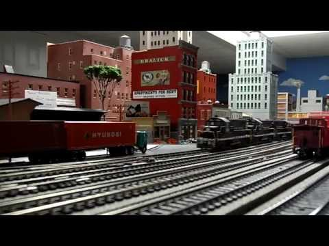 NYC GP20s with Freight Train