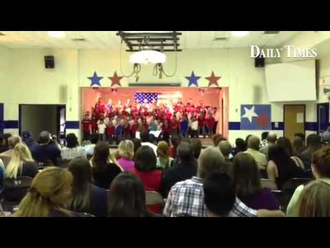 """Family members watch Bluffview Elementary School fourth graders sing """"Fifty Nifty United States"""""""