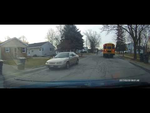 Driver Ignores School Bus Stop Sign and Lights