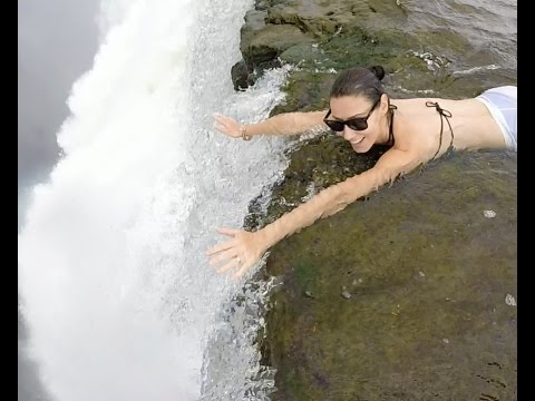 On the edge of the Victoria Falls at the Devils Pool in Zambia - Africa!