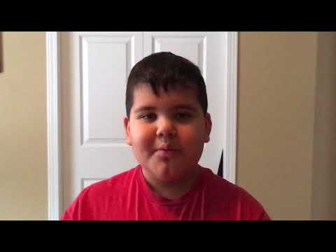 "8 year old Nolan sings "" Lonely Drum"" by Aaron Goodvin."