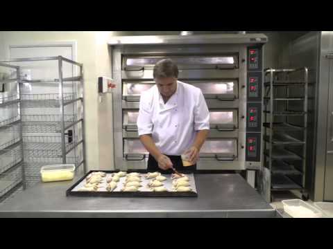 bread and pastry baking on a professional deck and rack oven