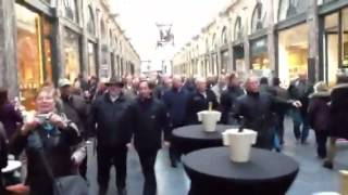 German men choir is in Public Passage in Brussels