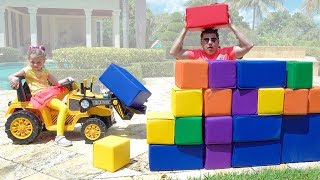 Stacy and Dad are building a Lego house