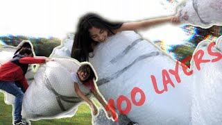 100 LAYERS OF BUBBLE WRAP CHALLENGE w/ FAMILY!!! | Estephon Aguilar