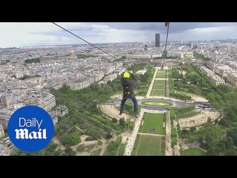 Thrill-seekers zipline from