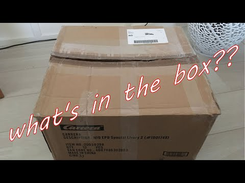 Unboxing a new slot race shipment, Carrera, Slot.it and SCX