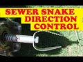 How to get a drain snake cleaner cable through tees going the right way