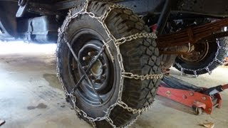 Installing snow tire chains - Heavy duty cleated v-bar chains on my plow truck