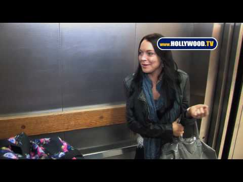 Private Security, Airport Security and Police Restrain Eager Paparazzi From Lindsay & Ali Lohan
