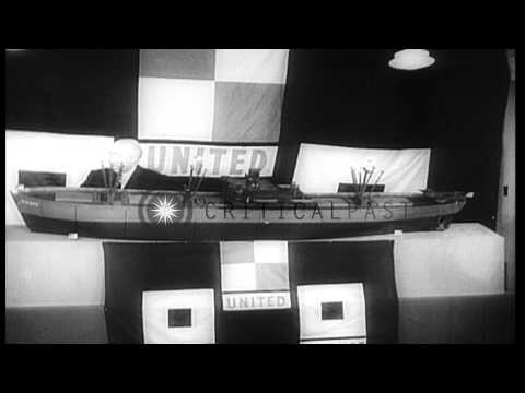 Flat-bottom tank carrrier ships launched.Henry J Kaiser with model of victory shi...HD Stock Footage