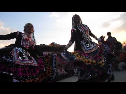 Beautiful gypsies dancing at sunset in Rajasthan India