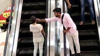 vuclip Pulling Stranger Cheeks on Escalator #Allahabad #Prayagraj#India#Best Prank in India.