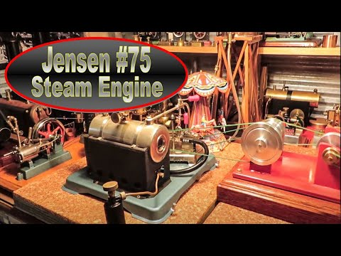 Jensen #75 running two Wilesco Fairground rides through a homemade transmission.