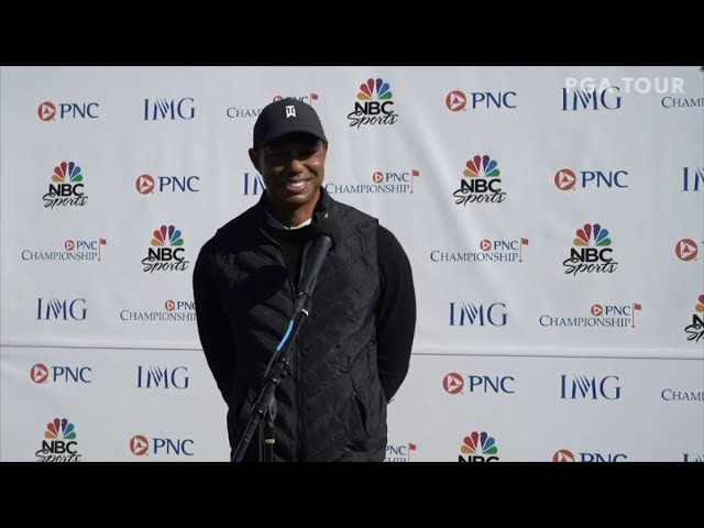 Tiger Woods Enjoying Playing And Chirping About The Golf Course With Son Charlie