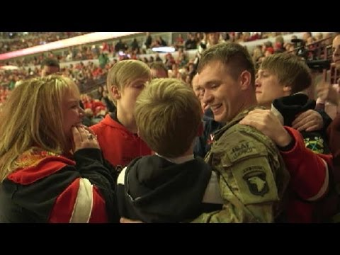 Soldier Surprises Family for Christmas at Blackhawks Game