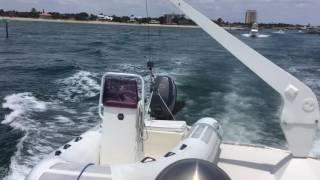 70 Ocean Cockpit Motor Yacht Facing Aft Leaving Inlet