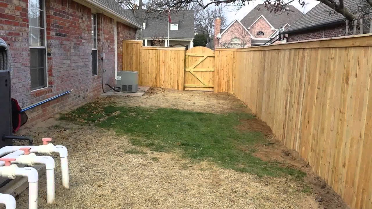 Capped cedar privacy fence with arched gates youtube capped cedar privacy fence with arched gates baanklon Image collections