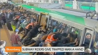 Watch Subway Riders Rescue a Trapped Man