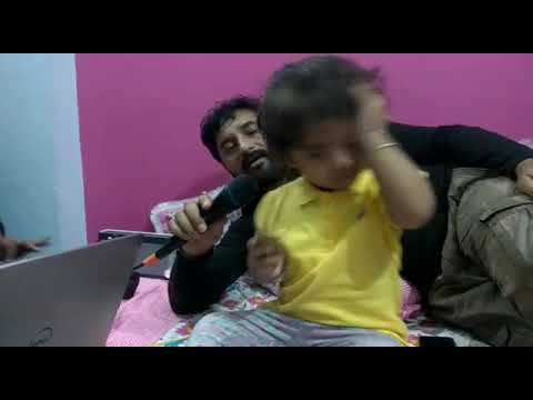 Indian Little girl(one and half years old) singing with her father