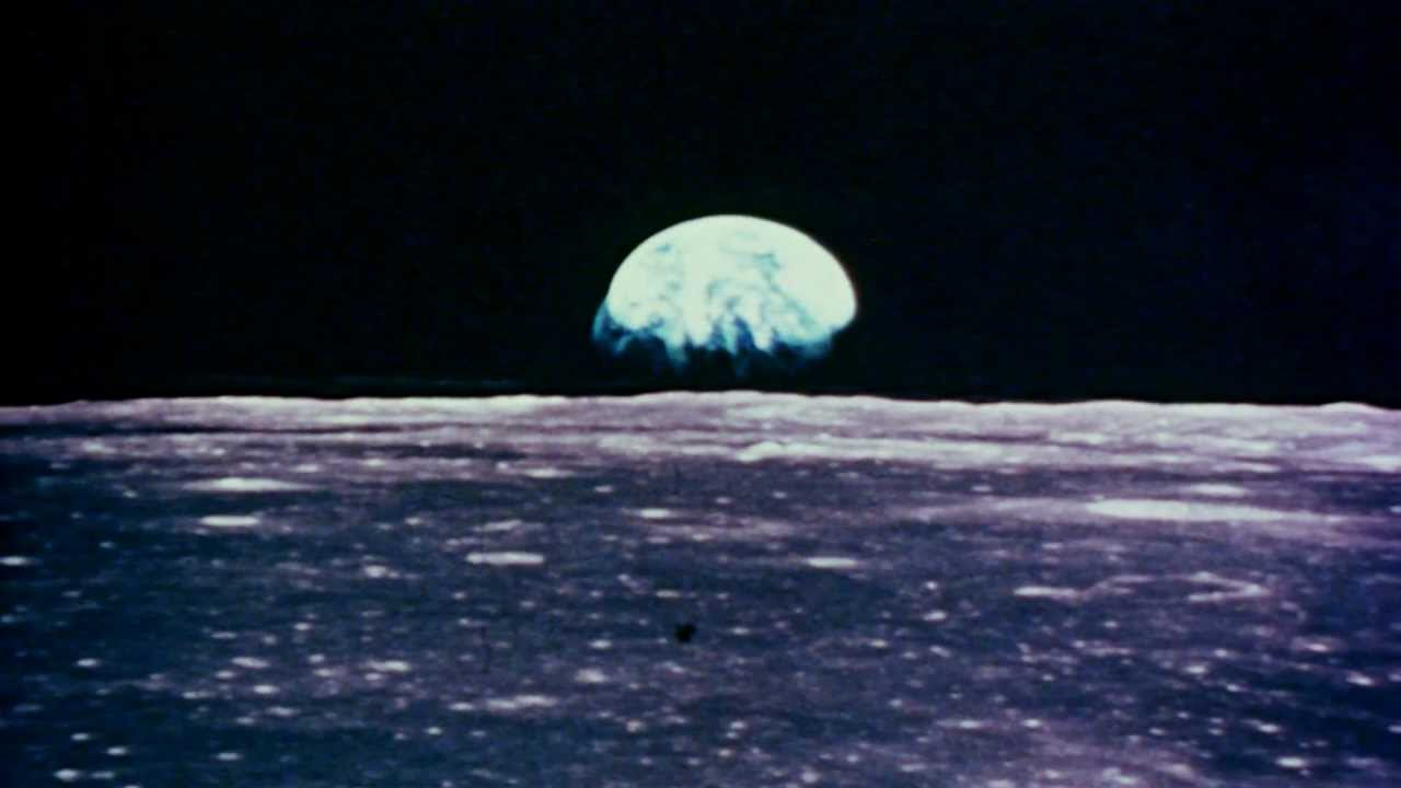 Earth Rises Over The Lunar Horizon