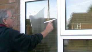 How to wash a window using a mop and squeegee
