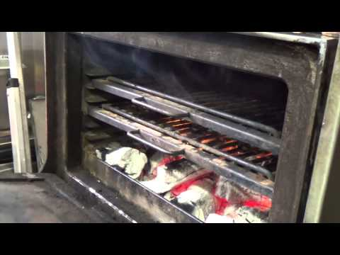 Cooking steak on the Josper at Blackwood's Bar & Grill at the Nira Caledonia
