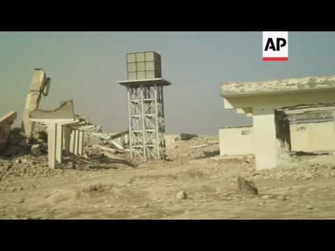 Iraqi police examine mass grave and IS prison