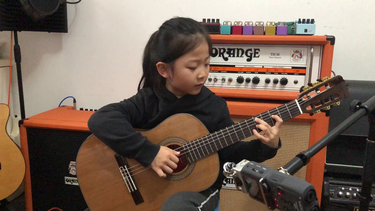 Nice Guitar Performance by a 6 Year Old!