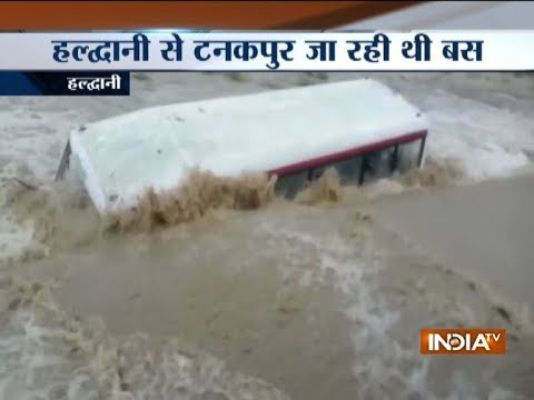 Bus washed away by swollen river in Uttarakhand