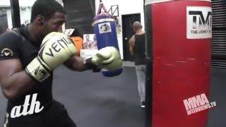 Undefeated Kickboxer Malik Blake hitting the heavy bag at Mayweather Boxing Club