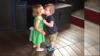 Adorable First Kiss Between Cute Baby Girl and Baby Boy