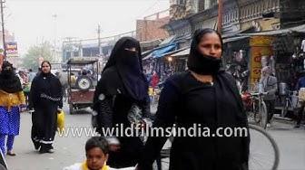 Ghanta Ghar market with crowds in Meerut, Uttar Pradesh