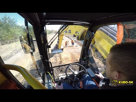 Liebherr A918 Excavator Loading TATRA Trucks With Clay - Cab View