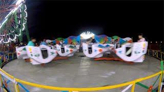 People enjoying rides at a fun amusement park during Dussehra fair