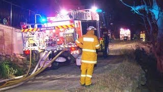 Fire crews protect property in Barden Ridge after a night time bush fire