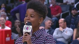 Watch 10-Year-Old Boy Shock Everyone With Incredible Voice at Basketball Game