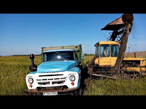 Погрузка земли мехлопатой ДТ-75