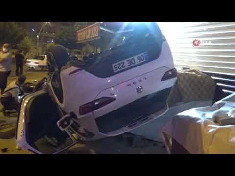 Kontrolden çıkan otomobil takla atarak marketin önünde durdu: 2 kişi ağır yaralı