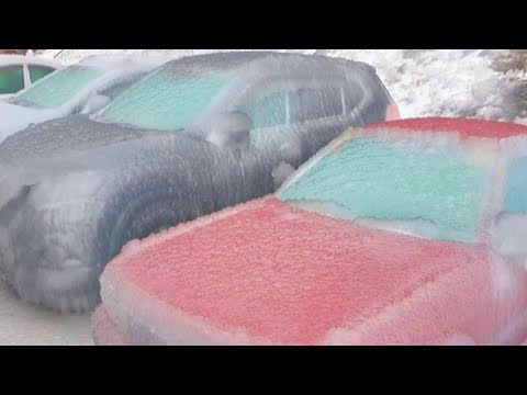Freezing rain in Vladivostok, Russia. Frost destroys trees, cars and poles. Ice storm. Disasters