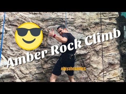 Wall climbing at the Amber Rock Climb in Universal Studios Singapore